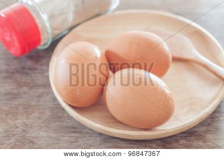 Fresh Eggs On Wooden Plate