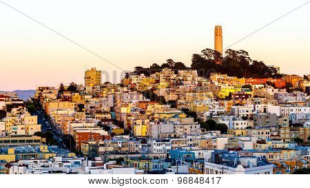Coit Tower And Houses On The Hill San Francisco At Dusk