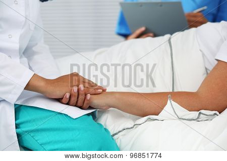 Friendly Female Doctor Hands Holding Patient Hand