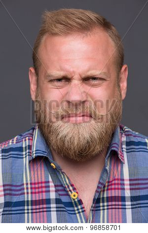 Discontented bearded man