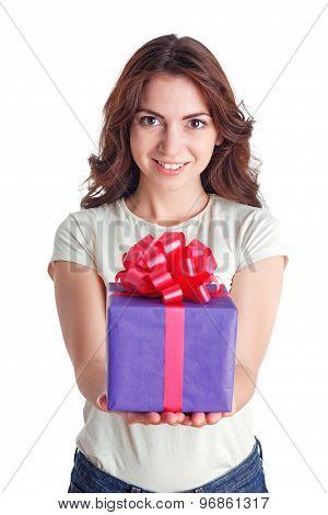 Smiling nice girl holding present