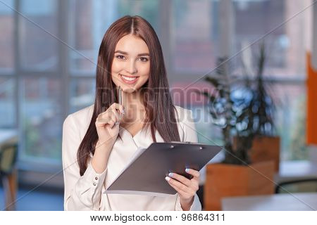 Smiling woman busy at work