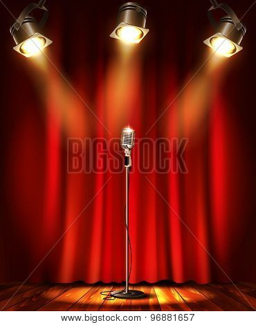 Stage with red curtians and microphone.
