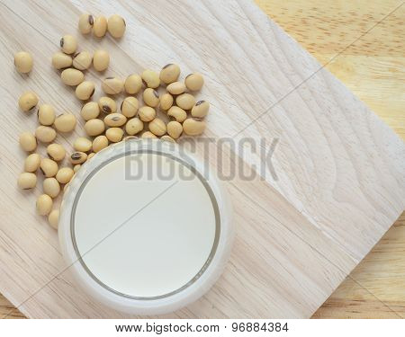 Fresh Soy Milk In A Glass And Soybean Seeds
