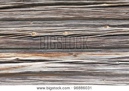 Close up on a wall of logs, timber.