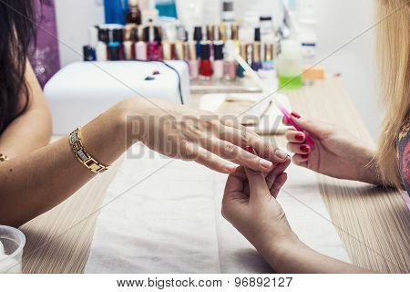 Beautiful Female Hands With The Beauty Salon, The Client And The Employee Makes Manikpur