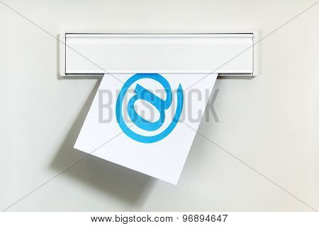 E-mail symbol on letter being delivered through a letterbox concept for internet communication, social media and contact us