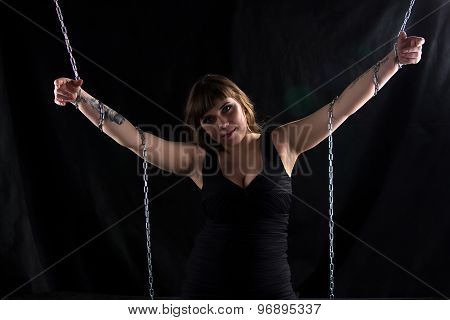 Photo of pudgy woman holding chains
