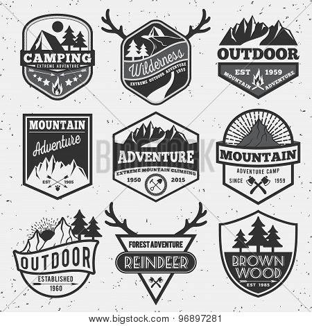 Set of monochrome outdoor camping adventure and mountain badge logo