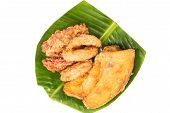 A serving consisting of the combination of fried banana (pisang goreng), fried sweet potatoes (keledek goreng) and fish nuggets (keropok lekor), a popular snack in Southeast Asia poster