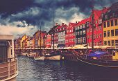 Copenhagen Nyhavn Retro Toned Image of Canal and District with its Colorful Facades on Cloudy Spring Day Beautiful Romantic Place in Denmark Capital poster