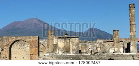 Pompeii. The Forum and Temple of Jupiter with Vesuvius in the distance. Pompeii was destroyed During a eruption of the volcano Vesuvius in AD 79.
