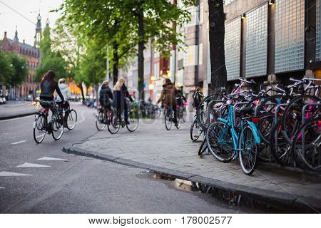 A stroll through the streets of Amsterdam. Bicycles on a city street. Travel through Europe. Ecological trasport. A bicycle on the road. Ride a bicycle. A bicycle stands on the side of the road