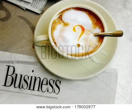 morning coffee with question mark and business section of the newspaper