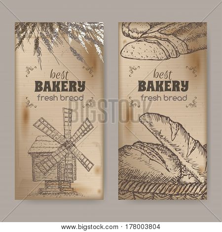 Set of two bakery label templates with wooden windmill, wheat and bread on vintage background. Great for bakery and bread shop ads, brochures, labels.