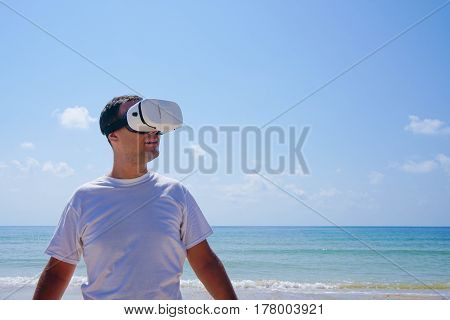 Man in Virtual Reality Glasses by the Sea in Thailand