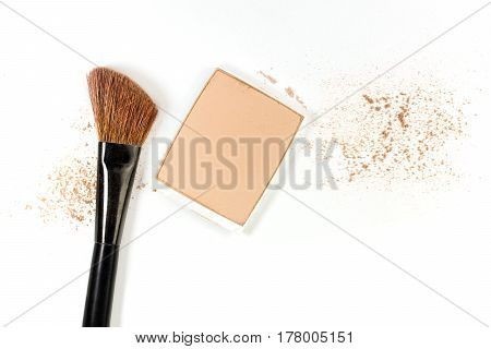 Makeup brush and powder, shot from above on a white background. A horizontal template for a makeup artist's business card or flyer design, with plenty of copy space