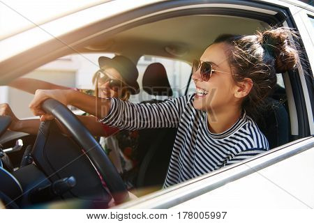 Two Fun Young Women Driving In A Car
