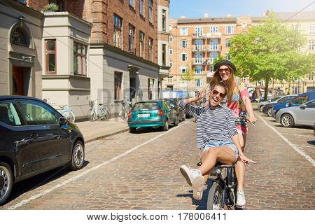 Friend Riding On Bike With Teen Girl
