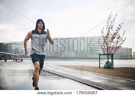 Man Jogging In Rainy Day