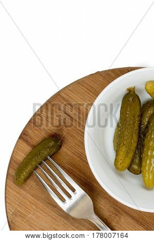 Pickles In The Bowl And Pickle On The Fork