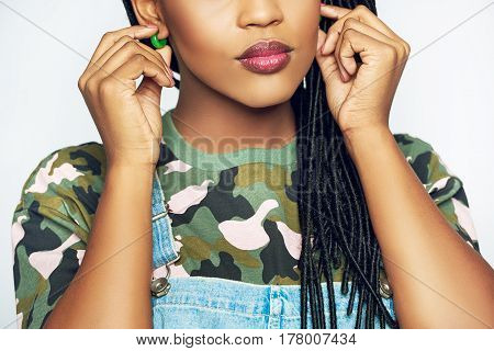 Young African Woman Adjusting Her Earrings