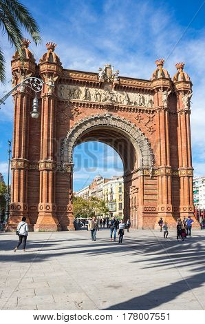 BARCELONA SPAIN - OCTOBER 22 2015: The Arc de Triomf is a triumphal arch in the city of Barcelona in Catalonia Spain. The arch is built in reddish brickwork in the Neo-Mudejar style