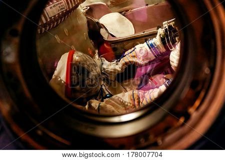MOSCOW, RUSSIA - JUNE 12, 2016: Russian/USSR astronaut in a spacesuit inside a capsule on exhibit at Moscow Space Museum
