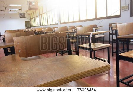 School classroom with desks chair wood and blackboard in high school thailand vintage tone education concept