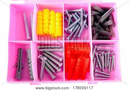 Pink box with screws and dowels isolated on white