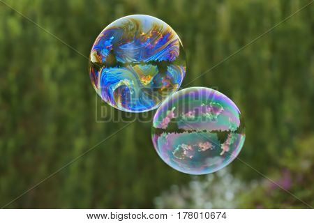 Soap bubbles flying in the air as background