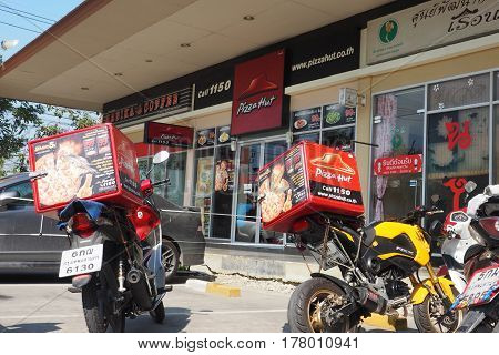Pizza Hut shop phone number and website and font of has 2 delivery motorcycle and heat storage box on 2017 March 11th. Wad lad pla duk Bangbuathong Nonthaburi Thailand branch in Lotus mini super market left is Rabika coffee right is Thai massage.