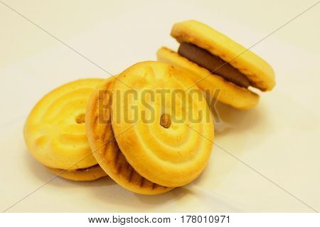 Biscuits or cookies coffee creamer three pieces on white background Photo macro focus select at center around are blur.