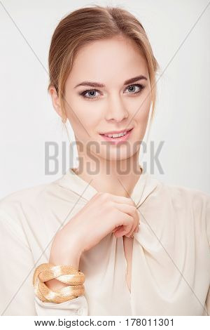 portrait of a beautiful young sensual blonde woman in white shirt smiling and looking at camera. sexy blonde
