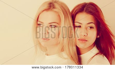 Blonde And Mulatto Girl Together.