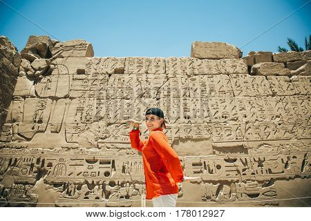 beautiful young girl travels to Egypt on the background wall