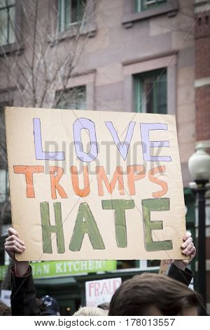 45th Presidential Inauguration, Donald Trump: Love Trumps Hate on a sign held by a protestor outside the security checkpoint, WASHINGTON DC - JAN 20 2017
