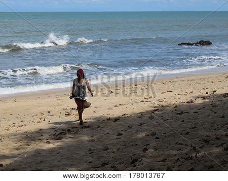 Woman Walking With Camera at Desaru Beach Johor Malaysia