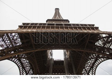 Travel through Europe. Eiffel Tower against the sky in Paris. Attractions in France. Eiffel Tower in Paris