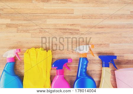 Spring cleaning concept - colorful sprays bottles and rubbers border, retro toned
