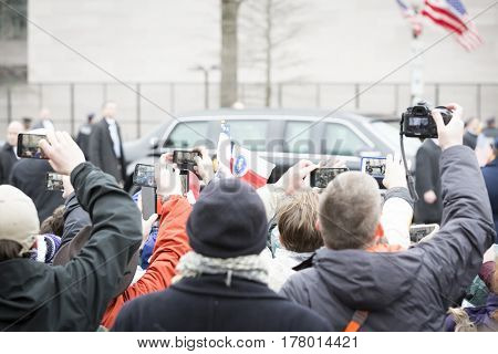 45th Presidential Inauguration, Donald Trump: People take pictures with cellphones of the Presidential Motorcade on Pennsylvania Ave, NW, WASHINGTON DC - JAN 20 2017