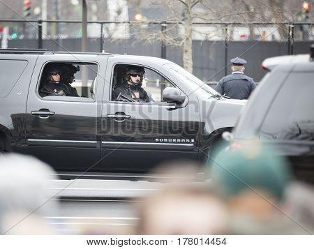 45th Presidential Inauguration, Donald Trump: Security personnel in black trucks follow the Presidential Motorcade during the parade on Pennsylvania Ave, NW, WASHINGTON DC - JAN 20 2017