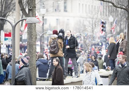 45th Presidential Inauguration, Donald Trump: A Russian Television reporter broadcasts live from the crowd on Pennsylvania Ave, NW, WASHINGTON DC - JAN 20 2017