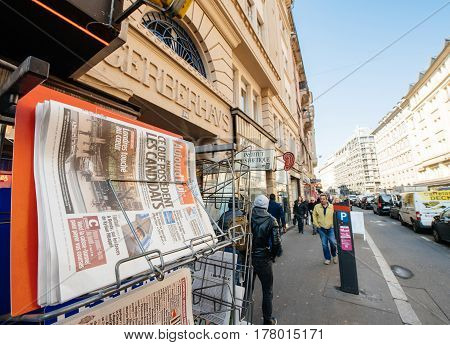PARIS FRANCE - MAR 23 2017: Aujord;Hui - Today French newspaper at press kiosk newsstand featuring headlines following the terrorist incident in London at the Westminster Bridge