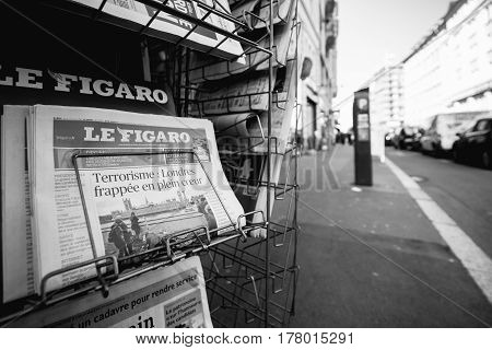 PARIS FRANCE - MAR 23 2017: Black and white Le Figaro French magazine newspaper from press kiosk newsstand featuring headlines following the terrorist incident in London at the Westminster Bridge