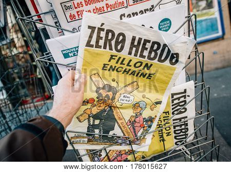 PARIS FRANCE - MAR 23 2017: Zero Hebdo satire magazine with caricature of Francois Fillon and text - Concatenated Fillon newspaper from press kiosk newsstand featuring headlines