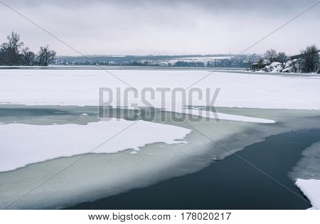 Seasonal landscape with frozen Dnepr river near Dnepropetrovsk city Ukraine