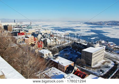 Quebec City and St. Lawrence River in winter, Quebec, Canada. Historic District of Quebec City is UNESCO World Heritage Site since 1985.