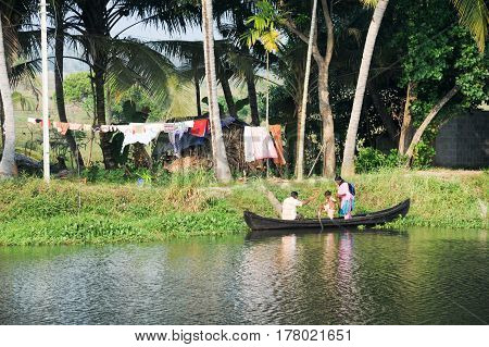 Family Cruising On A Canoe Near Alleppey On Kerala Backwaters