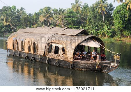 Traditional Indian Houseboat Cruising Near Alleppey On Kerala Backwaters